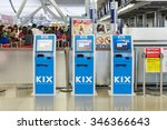 Small photo of OSAKA, JAPAN - DECEMBER 1, 2015: Self Service Check-in kiosks machine at Kansai International Airport KIX. Many airlines offer passengers the option of checking in, reserve seat, print boarding card