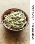 Small photo of Fancy organic spinach fetuccine pasta with creamy alfredo sauce