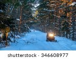 Snowmobiles Travel On A Winter...