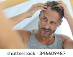 middle aged man concerned by... | Shutterstock . vector #346609487