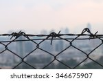 Small photo of Maintaining the safety querent Wire border fence land The free and Wong remembers. Prisoner detention arrest desolation desperation saboteurs anxious flinch violence hostage solitude loneliness man