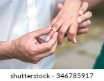 groom put the wedding ring on... | Shutterstock . vector #346785917