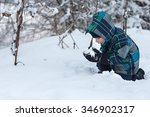 boy eating snow in the winter... | Shutterstock . vector #346902317