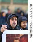 Small photo of NEW YORK CITY - DECEMBER 3 2015: Stop Mass Incarceration Network & the Revolutionary Club of NY marked the anniversary of a grand jury's failure to indict in the death of Eric Garner. Travis Morales