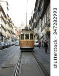 Small photo of PORTO-PORTUGAL NOVEMBER 1, 2015: In 1872, the tram service opened the first mule tram line in Porto. The service used only three trams at this day. Tramways are popular with the tourists.