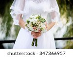 wedding bouquet in hands of... | Shutterstock . vector #347366957