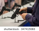 Small photo of Gun in his hand. Exhibition and sale of weapons