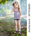 Small photo of Pretty little girl near brome, natural green background