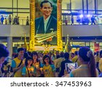 Small photo of BANGKOK, THAILAND - DECEMBER 5, 2015: Thai People crowd wear yellow shirt, sing, celebrate, sign well-wishing book, selfie, candle-lighting ceremony His Majesty the King's 88th birthday, Father day