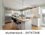 kitchen with white cabinetry | Shutterstock . vector #34747348