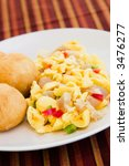 Small photo of Caribbean style vegetable dumpling (ackee) served with saltfish or codfish.