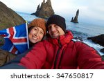 Tourist Couple Taking Selfie A...