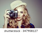 young woman with camera. blonde ... | Shutterstock . vector #347908127