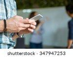 closeup of hands of young guy... | Shutterstock . vector #347947253