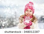 happy child girl plaing on a... | Shutterstock . vector #348012287
