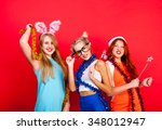 young nice girls have fun on a... | Shutterstock . vector #348012947