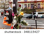 Small photo of Paris, France - November 21, 2015: Flowers in front of Le Bataclan with sign Eagle Of Death Metal, in memory of Paris victims after terrosists attacks of November 13th.
