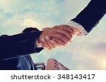 Small photo of Worm eye view shot of businessmen handshaking.acquisition concept.