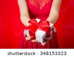 Woman Holding Christmas Presen...
