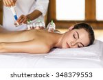 woman laying on chest with... | Shutterstock . vector #348379553