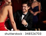handsome man playing in casino | Shutterstock . vector #348526703