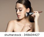 young woman applying blusher on ... | Shutterstock . vector #348604427