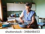 senior woman baking pies in her ...   Shutterstock . vector #348648653