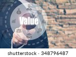 Small photo of Businessman pressing a Value concept button.