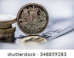 One Pound Coin Over Blur Credi...