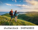 young couple hike in the... | Shutterstock . vector #348960803