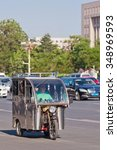 Small photo of BEIJING-MAY 29, 2013. Tricycle motor taxi downtown. This small taxi is similar to Thailand Tuk Tuks, Philippines Tricycles and Vietnam Cyclo, cost 20 RMB short ride (3 KM), 5 RMB per KM afterwards.