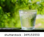 glass water ice glass on green... | Shutterstock . vector #349153553