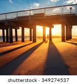 Ocean Pier Under Warm Sunset