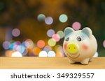 Saving Money In Piggy Bank On...