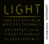 alphabet of yellow on dark... | Shutterstock . vector #349396097