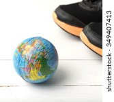 running shoes and earth ball on