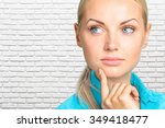 portrait of a thoughtful woman   Shutterstock . vector #349418477