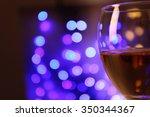 wine glass with bokeh on dark... | Shutterstock . vector #350344367