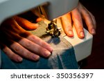 woman works at a sewing machine.... | Shutterstock . vector #350356397