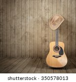Cowboy Hat And Guitar Against ...