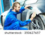 Постер, плакат: auto mechanic worker applying