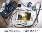 stack of photos and old camera | Shutterstock . vector #350655647