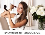 smiling woman in dress applying ... | Shutterstock . vector #350705723