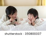 cute asian children lying on... | Shutterstock . vector #350800337