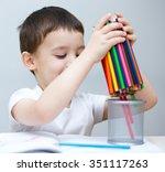 little boy is holding bunch of... | Shutterstock . vector #351117263