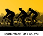 Bicyclist Riding Bicycle Group...