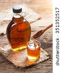 maple syrup in glass bottle on... | Shutterstock . vector #351352517