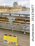 Small photo of PARIS, FRANCE - DECEMBER 6, 2015: Locks for sale at Love locks bridge in Paris. Ritual of affixing padlocks, as symbol of love, is spread from 2000s. Selective focus on locks attached to railing.