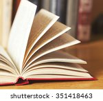 book with library on the back  | Shutterstock . vector #351418463