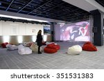 Small photo of ST. PETERSBURG, RUSSIA - DECEMBER 13, 2015: Girl watch the video installation of AES+F group Inverso Mundus in the central exhibition hall Manege during 4th St. Petersburg International Cultural Forum